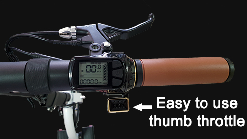 View showing thumb throttle, speedometer, and brake lever